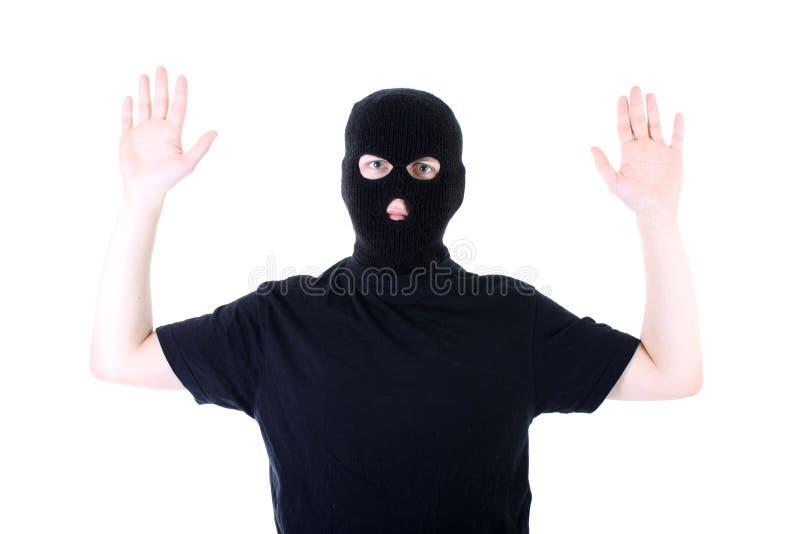 De overgegeven misdadiger in een masker royalty-vrije stock foto
