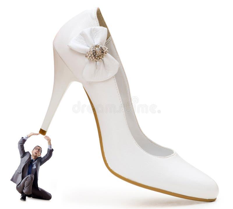 De overheersingsconcept van de vrouw - schoenen en man royalty-vrije stock afbeelding