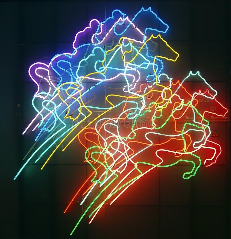 De paarden en de ruiters van het neon stock afbeelding