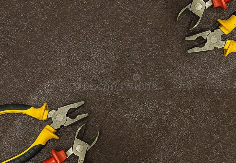 De pagina's van de decoratieprentbriefkaaren van de kaderhoek registreren instrumenten de elektroreparatie symmetrische tangen va stock fotografie