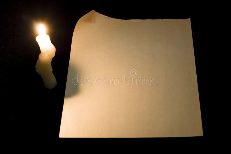 De pagina van het document met krul en kaars stock fotografie