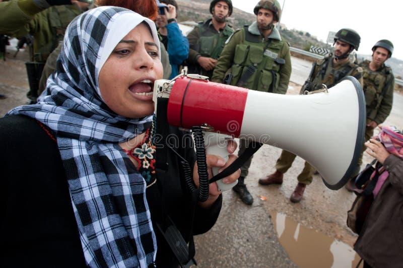 De Palestijnen protesteren Israëlische Muur stock foto