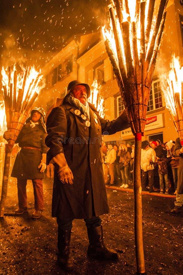 De parade van Chienbasefastnach en deelnemers in Liestal, Zwitserland royalty-vrije stock fotografie