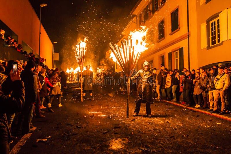 De parade van Chienbasefastnach en deelnemers in Liestal, Zwitserland royalty-vrije stock afbeelding