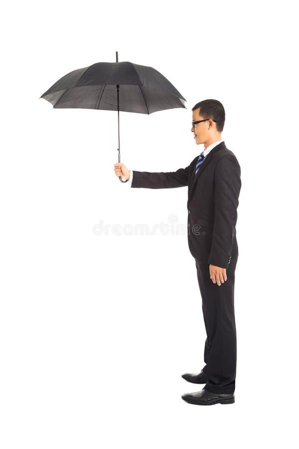 De paraplu van de zakenmanholding status stock fotografie