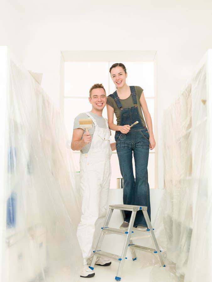 De paren van de thuiswerkliefde stock foto's