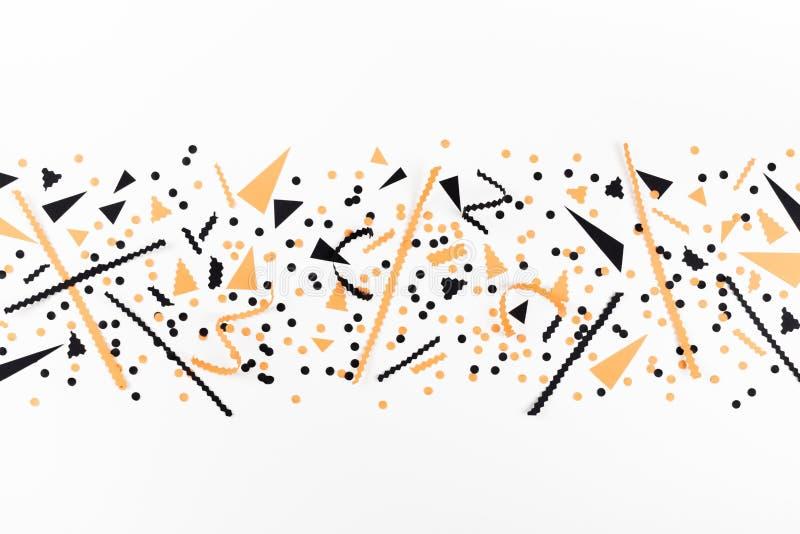 De partijdecoratie van Minimalistichalloween van zwarte en oranje confettien hoogste mening Vlak leg stock illustratie