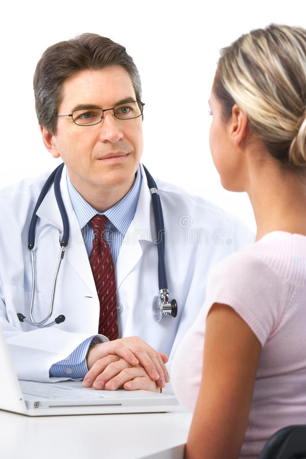 De patiënt van de arts en van de vrouw stock foto's