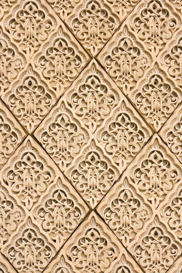 De patronen van het oosten op een muur stock foto