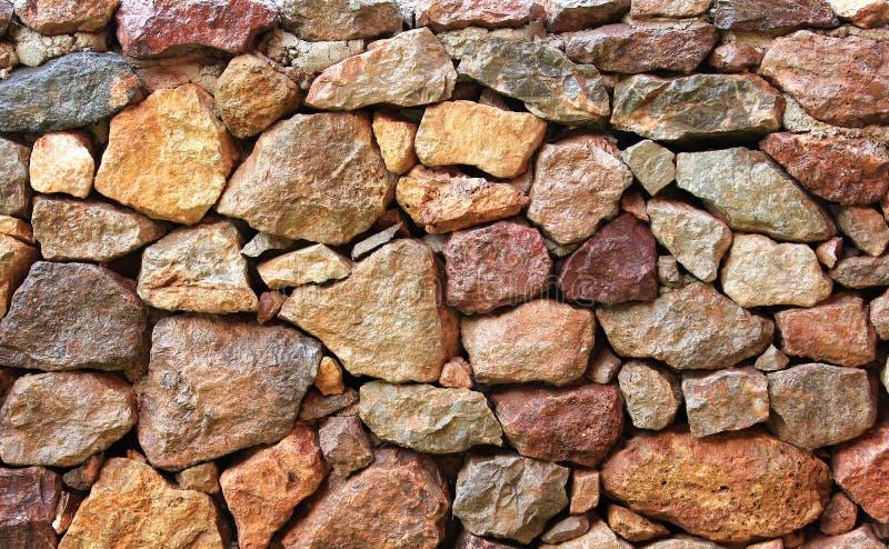 De patroonschoonheid van rode steenachtergrond, sluit omhoog mooie oppervlakte en textuurrots voor ontwerp en decoratief stock afbeeldingen