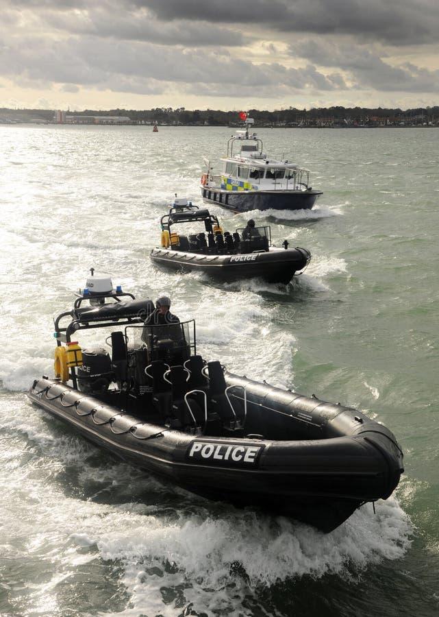 De patrouilleboten van de politie stock afbeeldingen