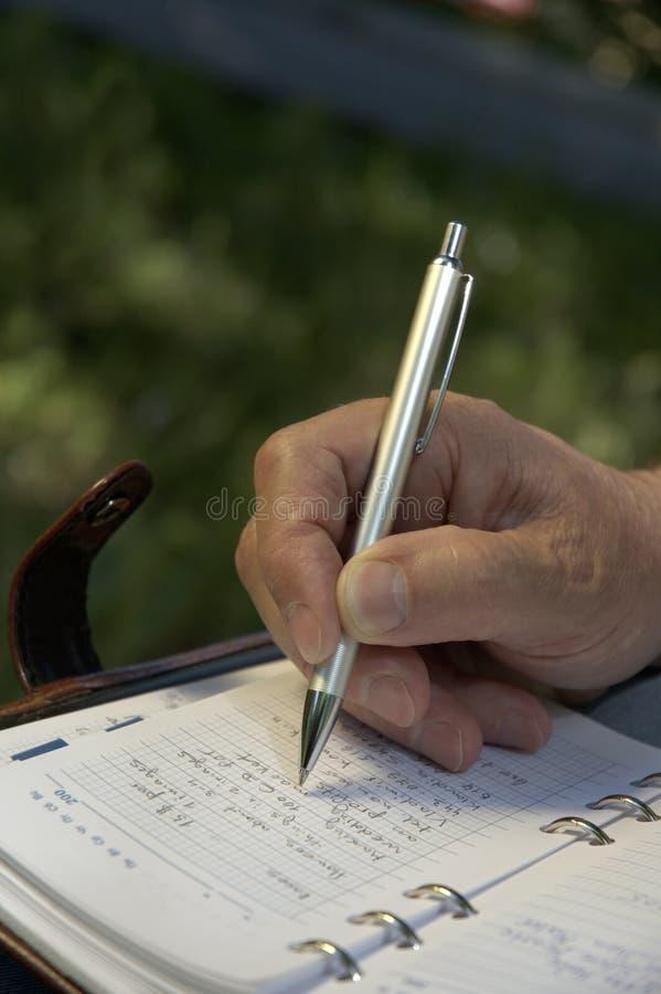 De pen van de hand whith stock foto