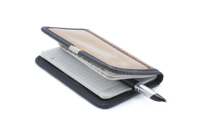 De pen van het notitieboekje en van de pen stock afbeeldingen