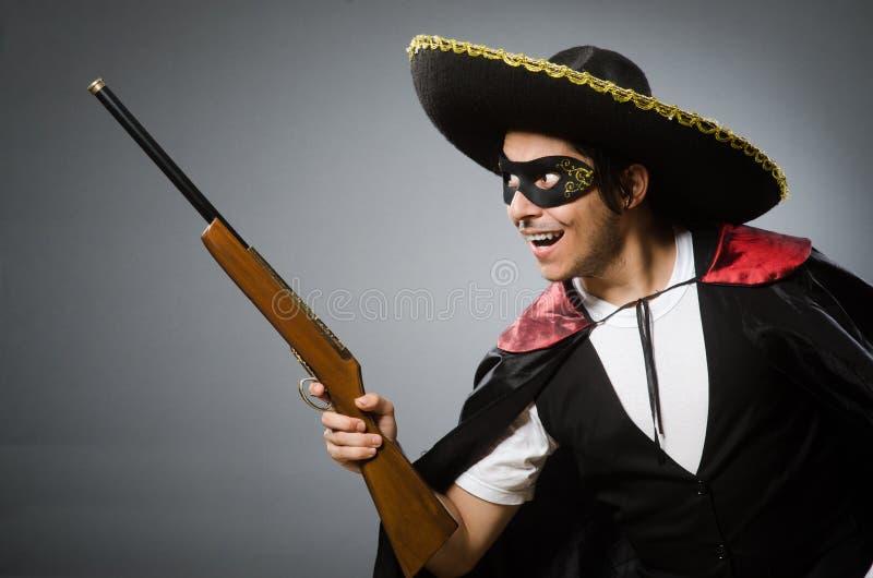 De persoon die sombrerohoed in grappig concept dragen stock foto's