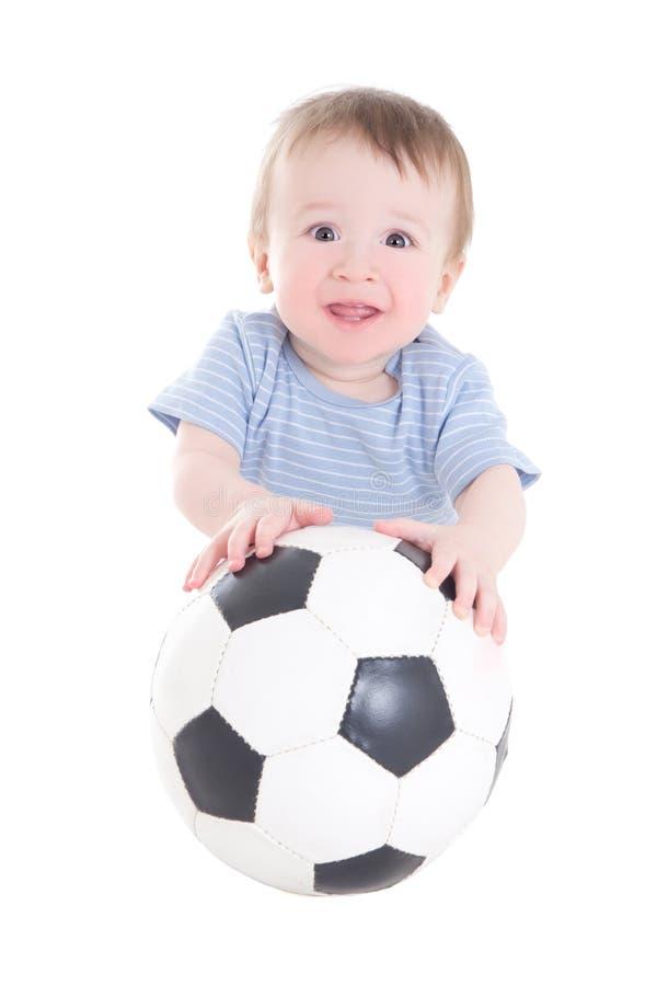 De peuter van de babyjongen met voetbalbal op wit wordt geïsoleerd dat royalty-vrije stock foto