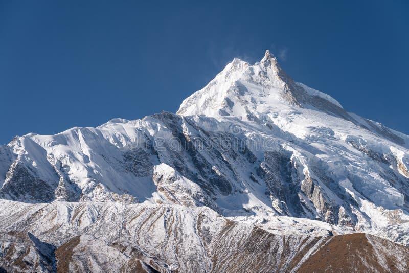 De piek van de Manasluberg, achtste hoogste bergpiek in de wereld, de bergketen van Himalayagebergte, Nepal stock fotografie
