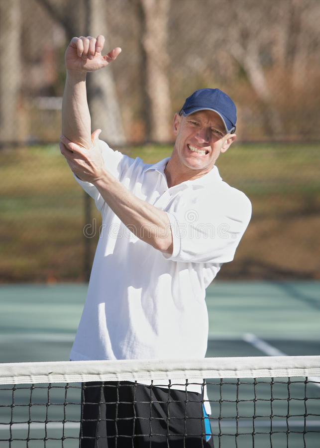 De pijn van de tenniselleboog stock fotografie