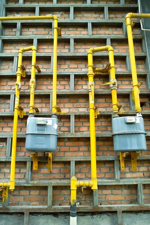 De pijpmeter en klep van het gas stock fotografie