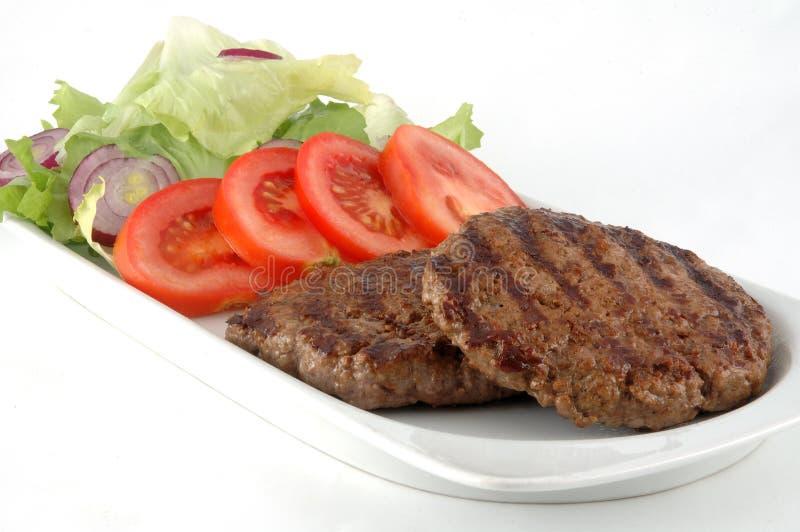 De plaat van de hamburger stock foto's