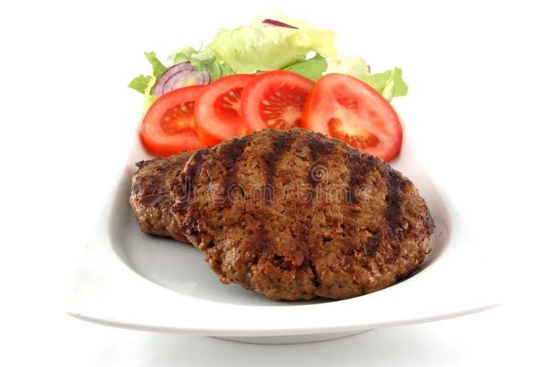 De plaat van de hamburger stock afbeeldingen