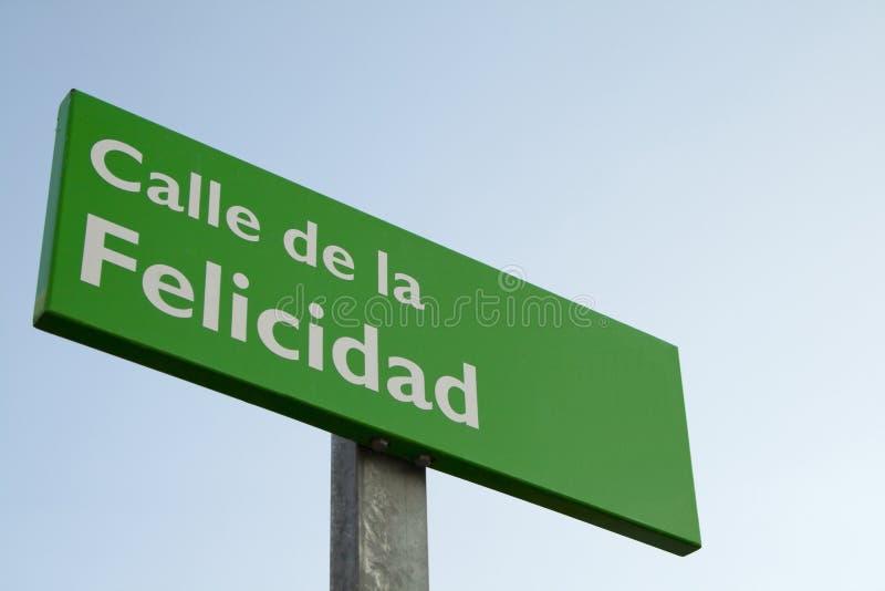 De plaat van de Happynessstraat in het Spaans stock foto's