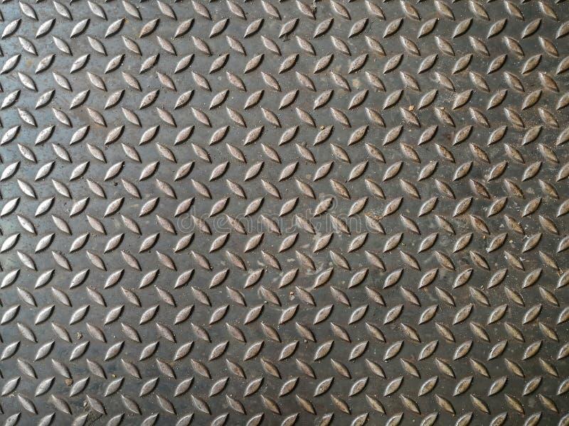 De plaat van het diamantstaal met de achtergrond van de roesttextuur stock afbeeldingen