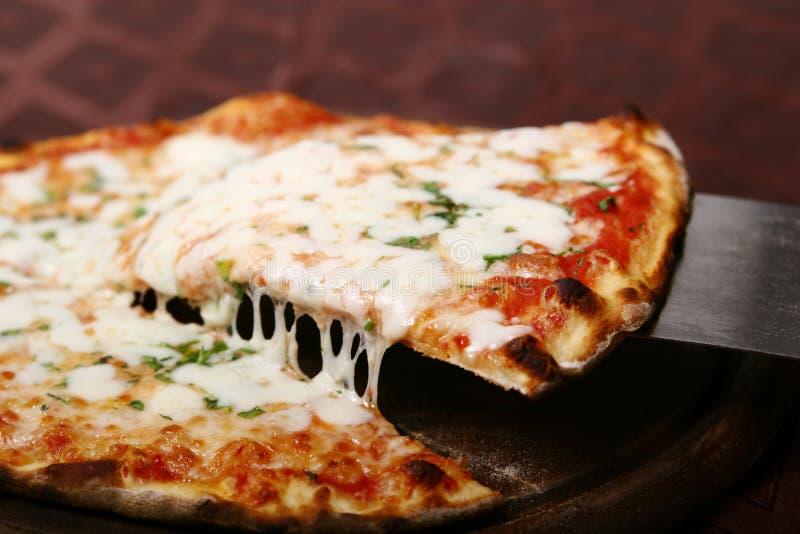 De plak van de pizza stock foto's