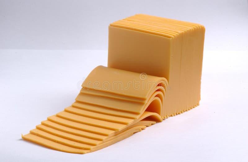 De plakken van de kaas royalty-vrije stock afbeeldingen