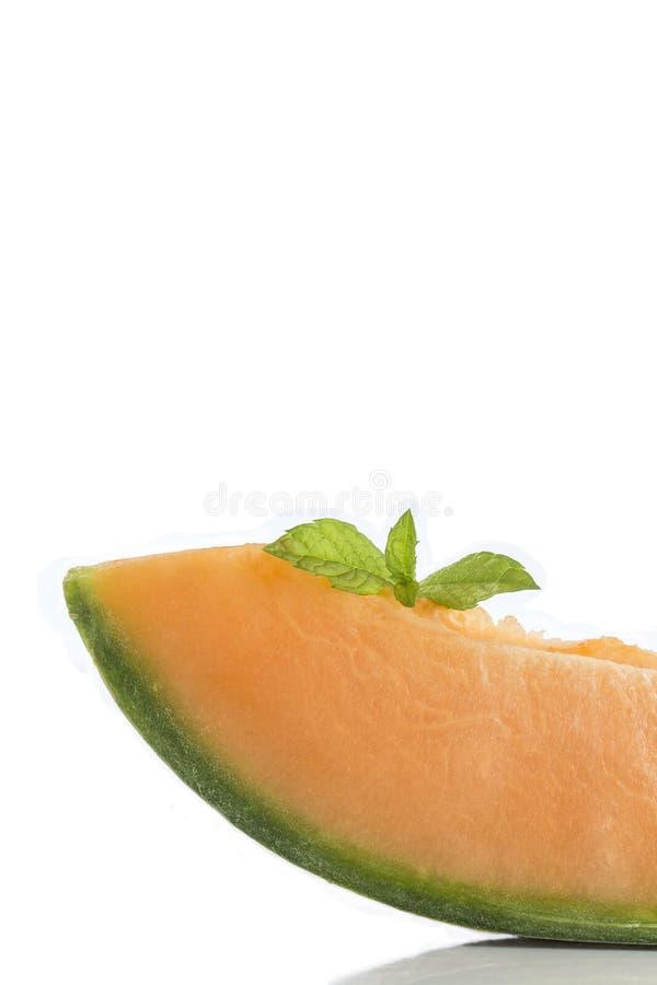 De plakken van de kantaloepmeloen met exemplaarruimte stock foto