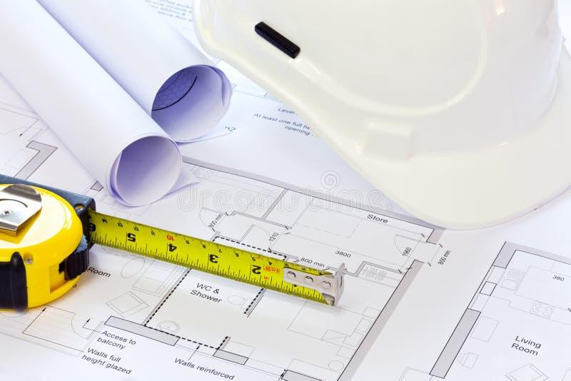 De plannen van de bouwvakker en van de bouw stock afbeelding