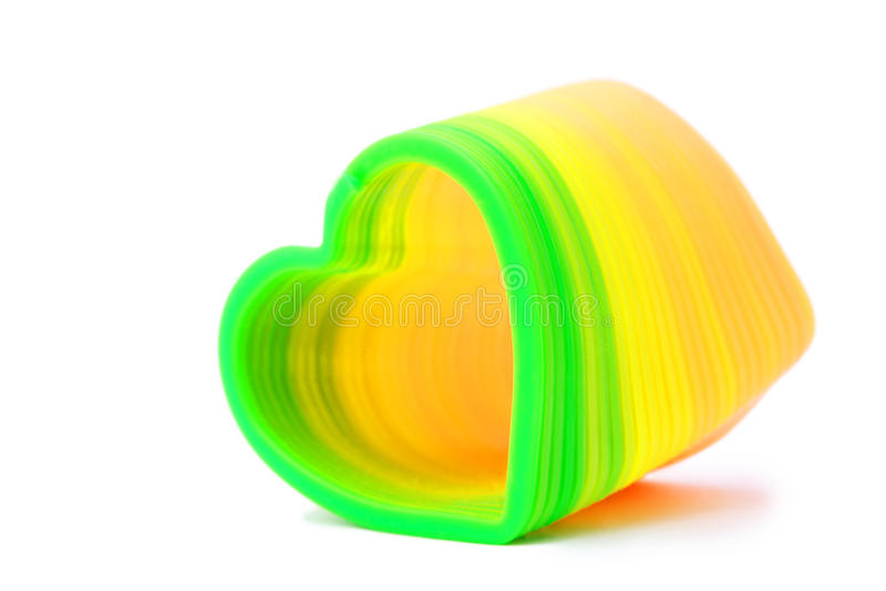 De plastic stuk speelgoed lente in hart-vormig royalty-vrije stock foto's