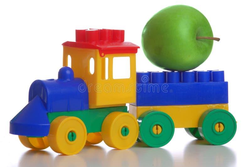 De plastic trein van het stuk speelgoed, witte achtergrond royalty-vrije stock afbeeldingen