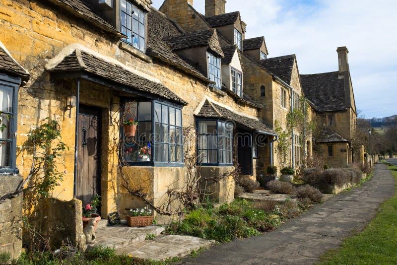 De plattelandshuisjes van Cotswold stock afbeelding