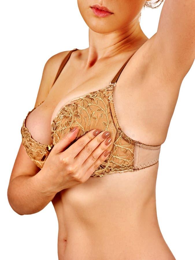 De pleegmoeder onderzoekt haar borsten stock foto