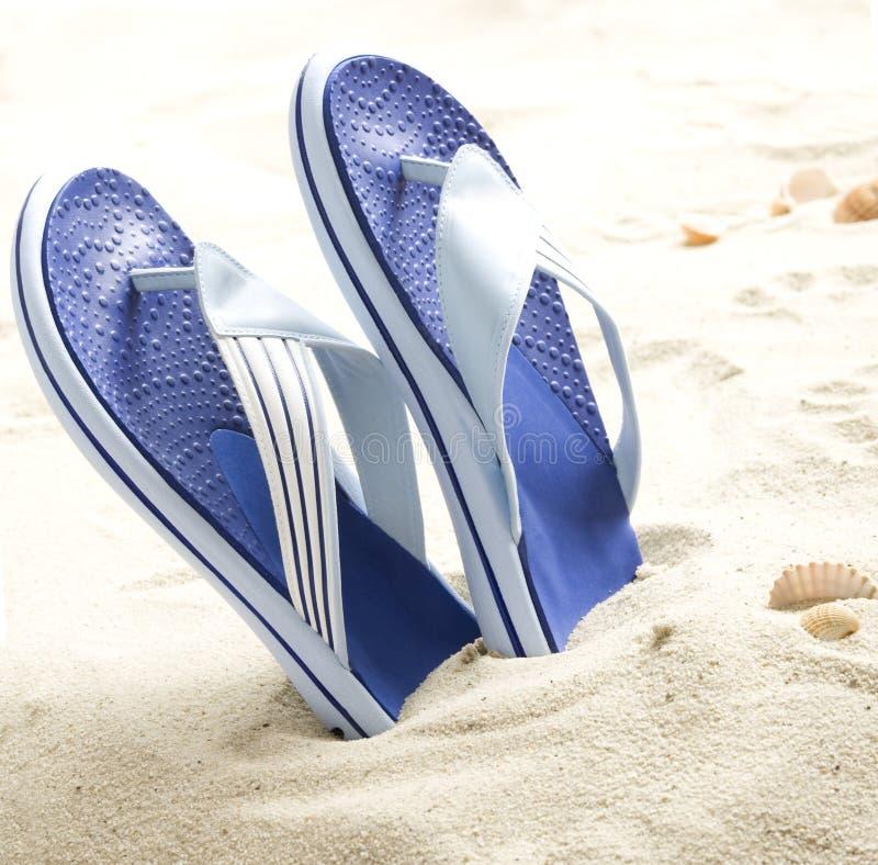 De ploffen van Flp op het strand stock fotografie