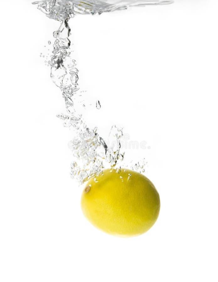 De plons van de citroen stock fotografie