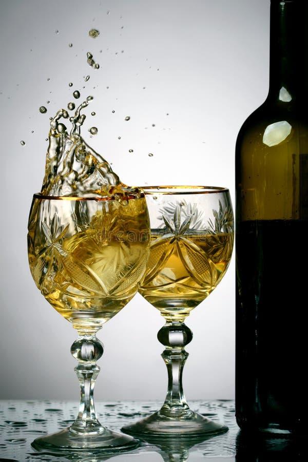 De plons van de wijn stock fotografie