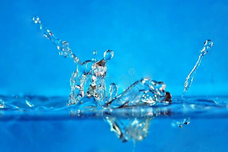 De plons van het water stock foto