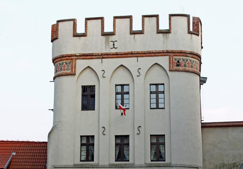 De poort van de brug, Torun, Polen stock foto