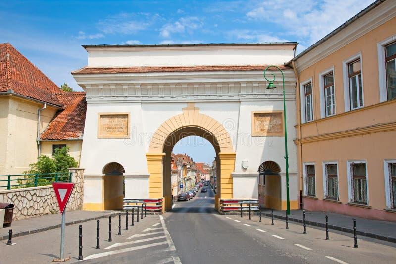 De poort van Schei in oude stad Brasov, Roemenië stock fotografie