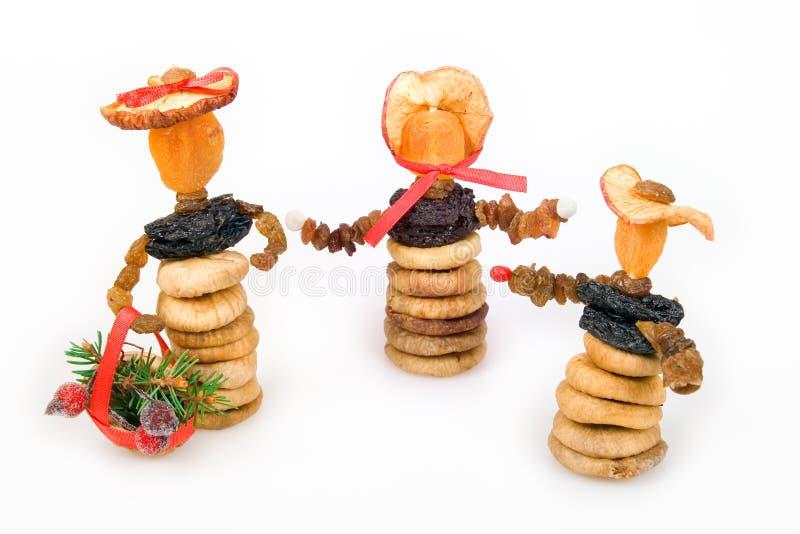 De poppen van Kerstmis van het gedroogd fruit stock foto's