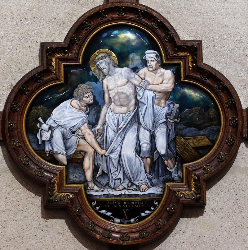 de 10de Posten van het Kruis, Jesus is gestript van Zijn kledingstukken stock afbeeldingen