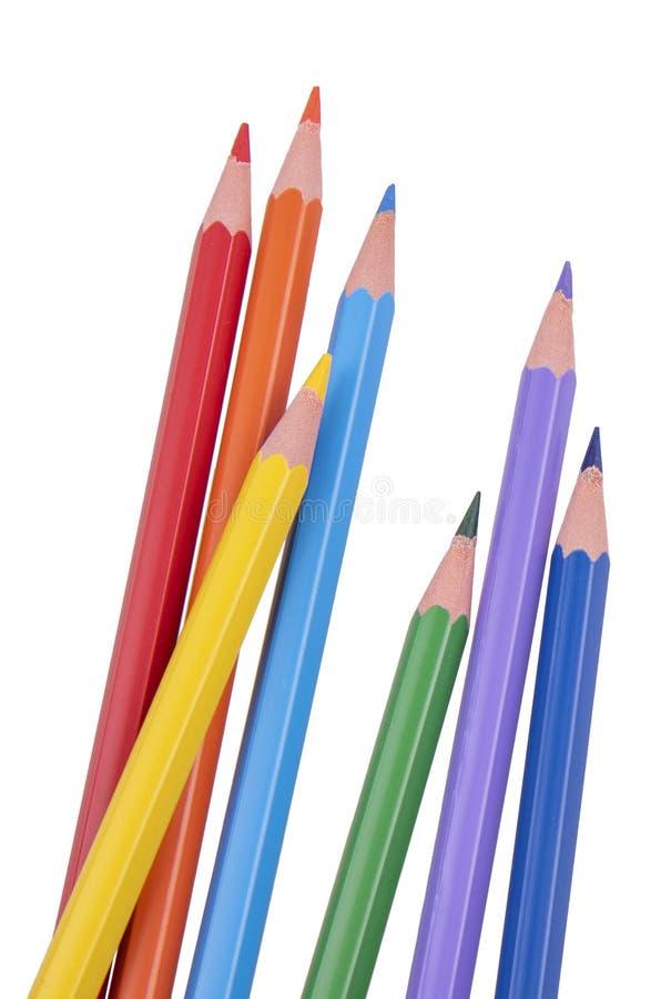De potloden van de kleur die op witte dichte omhooggaand worden geïsoleerd? als achtergrond stock foto