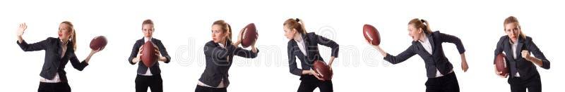 De preety die bureauwerknemer met rugbybal op wit wordt geïsoleerd stock foto's