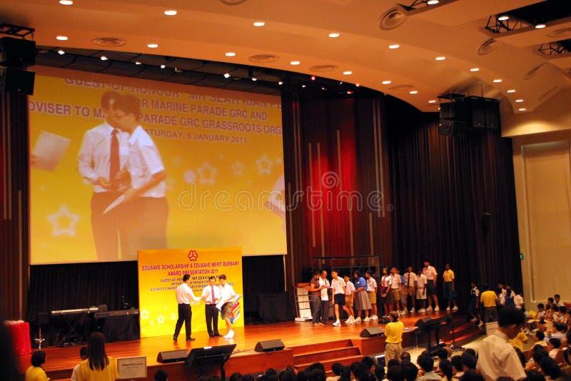 De presentatie van de toekenning voor de hoogste 10% student van School stock fotografie
