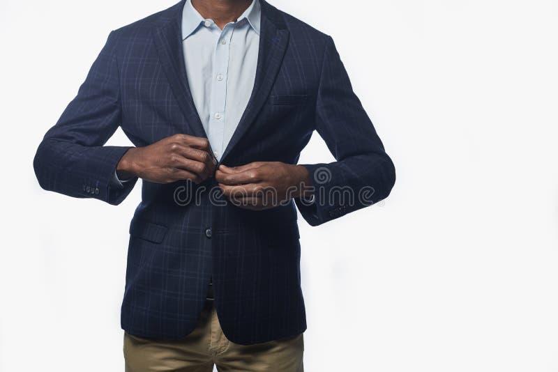 De prettige manager stelt in kostuum stock afbeelding