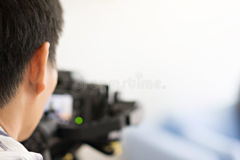 De professionele fotografen schieten videoklemmen en foto stock fotografie