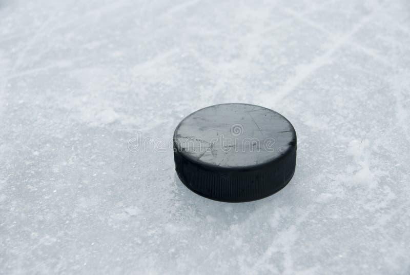 De puck van het hockey op ijs royalty-vrije stock afbeelding