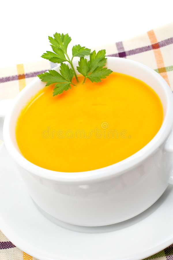 De puree van wortelen met peterselie stock afbeelding