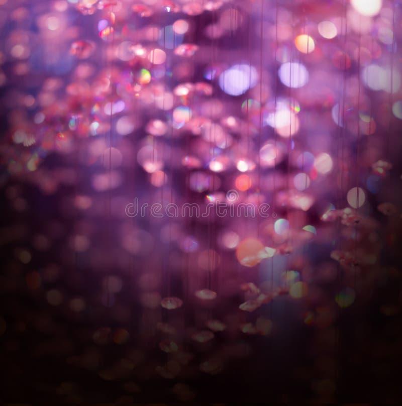 De purpere abstracte achtergrond van kristal bokeh Kerstmis stock fotografie
